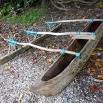 Traditional outrigger canoe at the beach
